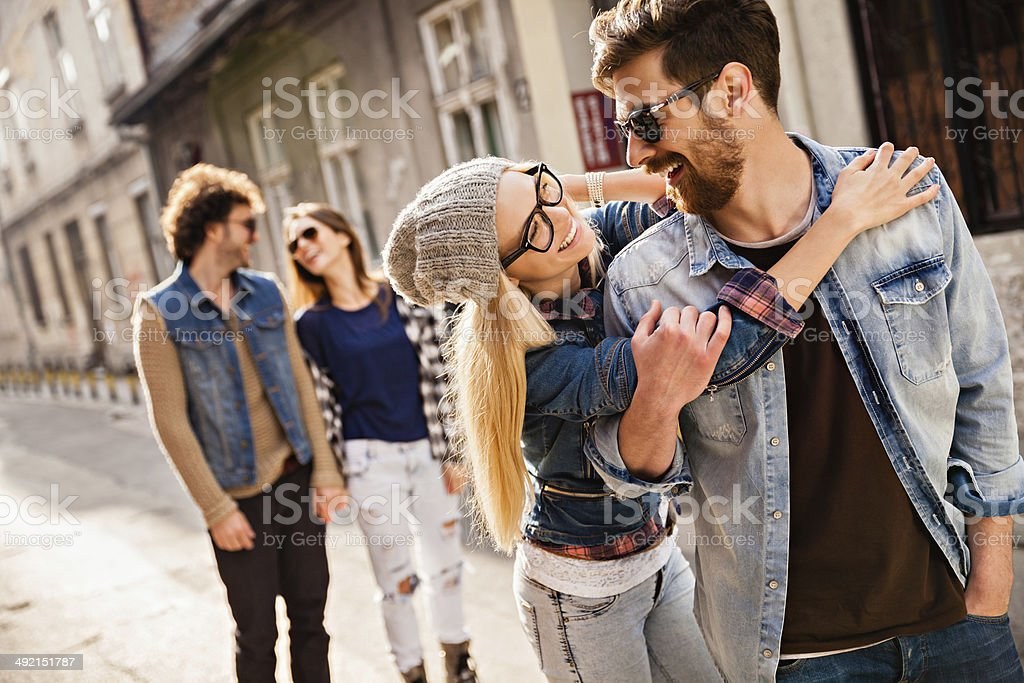 Photo of friends laughing and walking outdoors royalty-free stock photo
