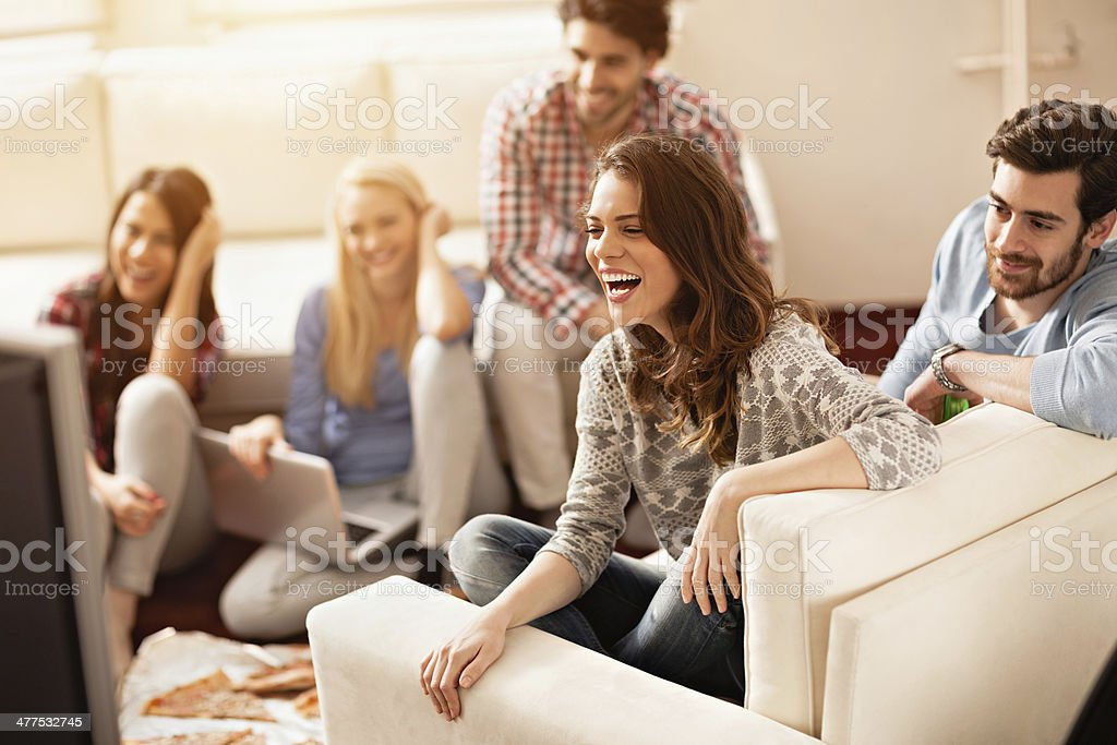 Photo of friends laughing and watching movie stock photo
