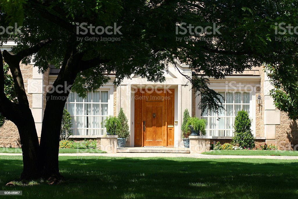 Photo of front yard and front of a beautiful home stock photo