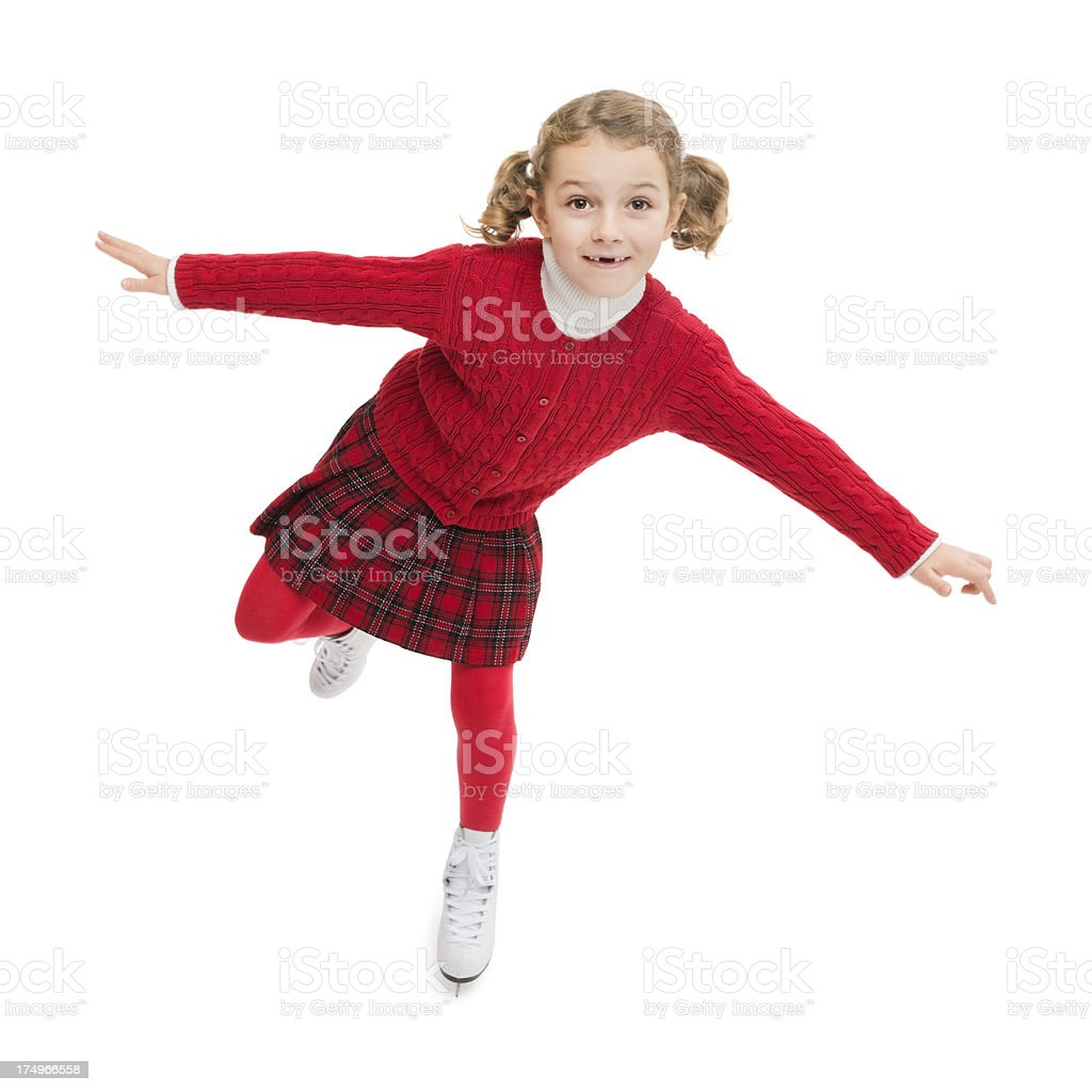Photo of girl missing teeth wearing all red, ice-skating.  royalty-free stock photo