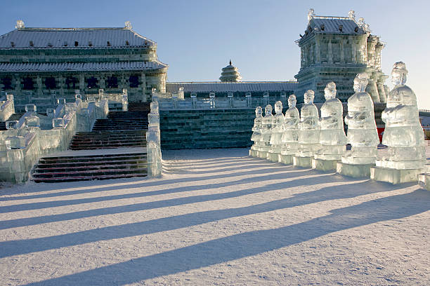 Photo of glass statues in Harbin Forbidden Palace ice sculpture at sunset during Ice Festival in Harbin, China harbin stock pictures, royalty-free photos & images