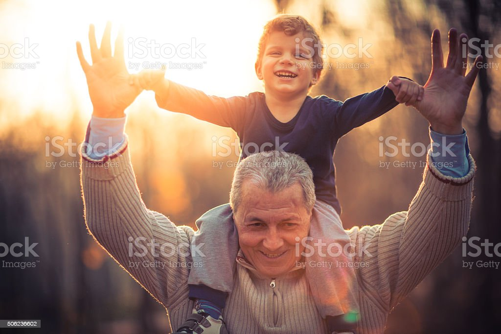 Photo of grandfather and his grandson in the park stock photo