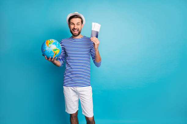 Photo of handsome funky guy hold world globe traveler prepare tickets picture id1210289198?b=1&k=6&m=1210289198&s=612x612&w=0&h=kv4aa9eats2w19zhaw0ydgoh3tzo8d gc8x0ceol2j0=