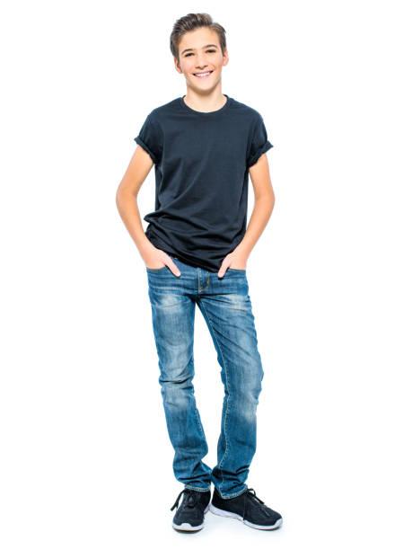 Photo of handsome teenage young guy Photo of handsome teenage young guy - looking at camera. Full portrait of pretty boy. 14 15 years stock pictures, royalty-free photos & images