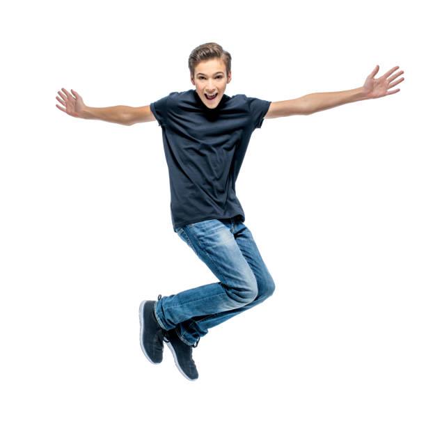 Foto von glücklich Teenager sprang mit Händen – Foto