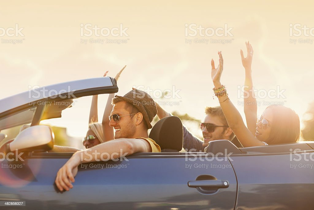 Photo of happy young people in convertible car stock photo