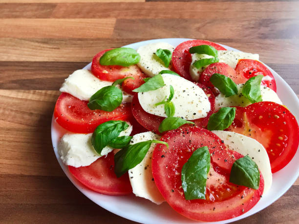 photo of healthy salad with mozzarella, tomato and basil - mozzarella foto e immagini stock