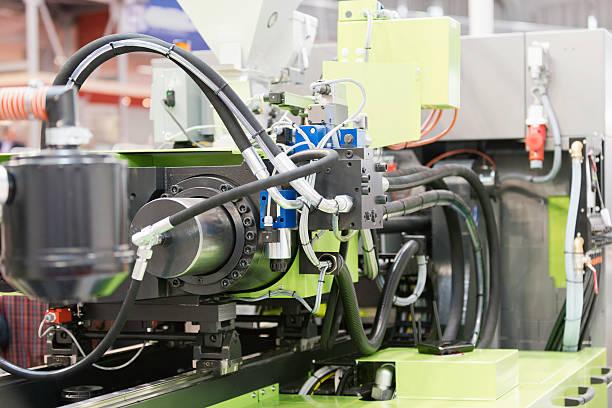 industrial injeção de plástico edificarmos máquina - moldando - fotografias e filmes do acervo