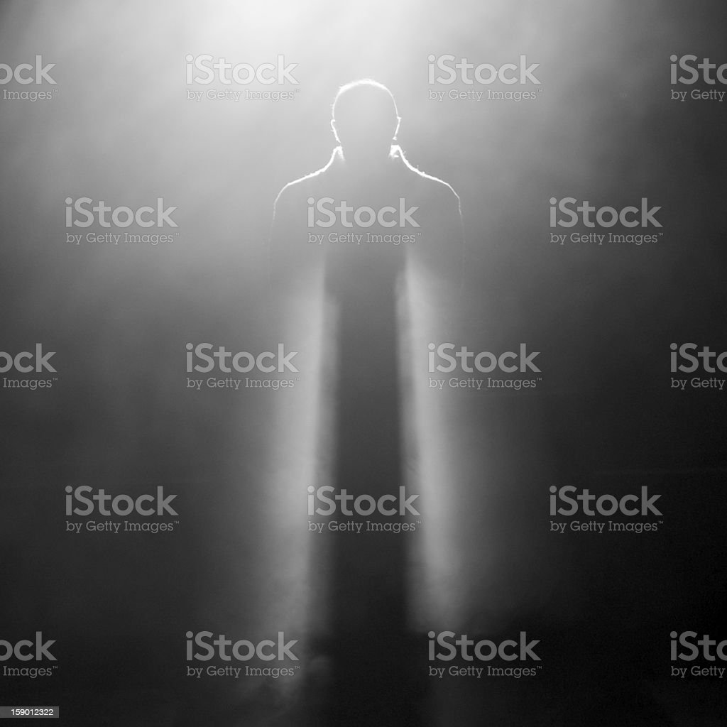 Photo of man standing on stage stock photo
