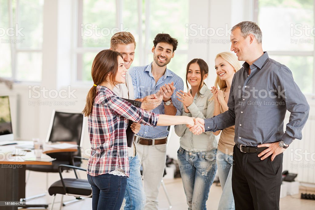 Photo of mentor and designer student shaking hands royalty-free stock photo