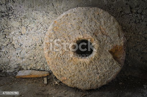 istock Photo of millstone leaning against wall 470325280