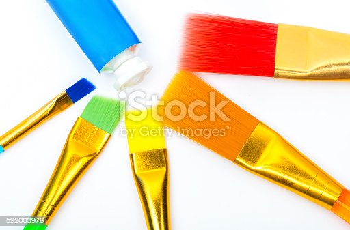 istock Photo of multicolor paint brushes isolated on white background. 592003976