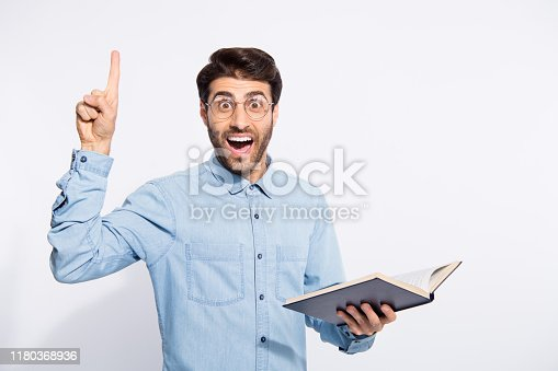 istock Photo of multiethnic clever guy holding planner indicating finger on black board explaining students theorem wear casual denim shirt isolated white color background 1180368936