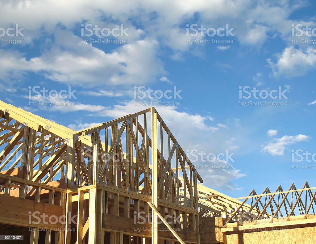 Photo of new construction wooden frame against blue sky royalty-free stock photo