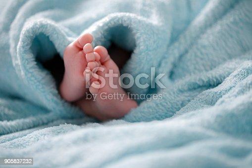 A close-up of tiny baby feet