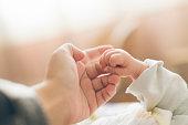 istock Photo of newborn baby fingers 1063148786