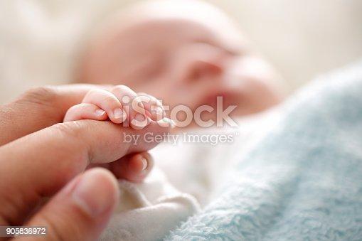istock Photo of newborn baby fingers 905836972