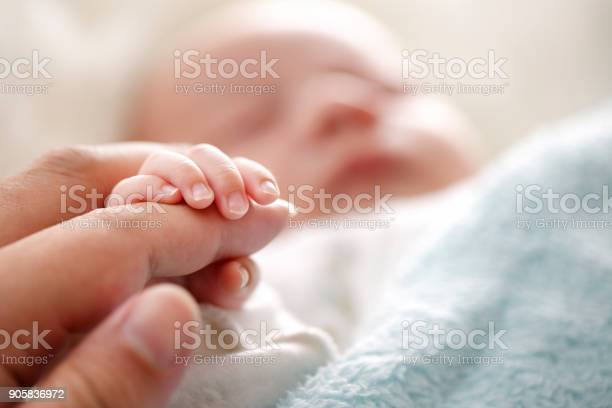 Photo Of Newborn Baby Fingers Stock Photo - Download Image Now