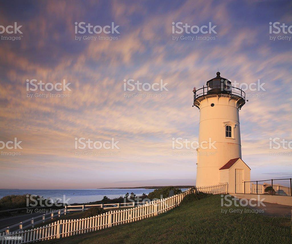 Photo of Nobska Point lighthouse against cloudy sky at dusk stock photo