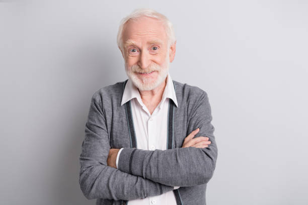 Photo of old optimistic man crossed arms wear dark sweater isolated on grey background stock photo