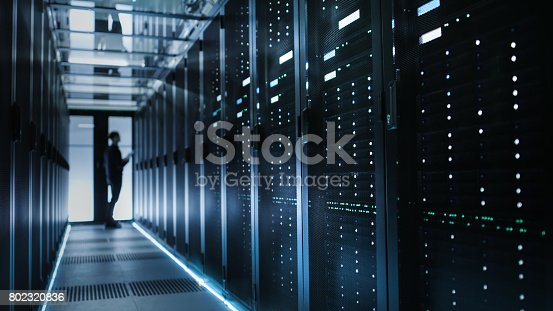 istock Photo of Out of Focus IT Technician Turning on Data Server. 802320836