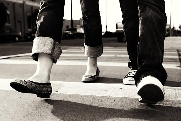 Photo of People Walking Across the Street stock photo