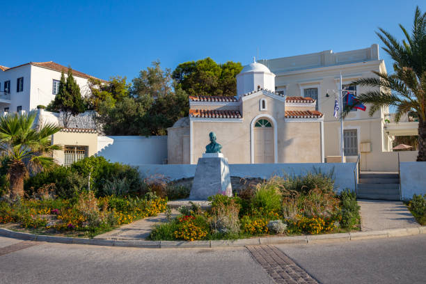 Photo of picturesque canon monument near church of Agios Mamas in historic and traditional island of Spetses with emerald clear water sea, Saronic Gulf, Greece stock photo