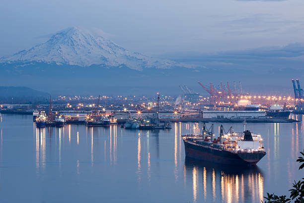 A photo of port Tacoma and a snow topped Mount Rainier Port of Tacoma With Mount Rainier In Background at dusk pierce county washington state stock pictures, royalty-free photos & images