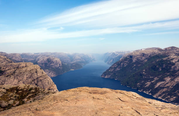 photo of preikestolen, pulpit rock at lysefjord in norway. aerial view. - cliff stock pictures, royalty-free photos & images