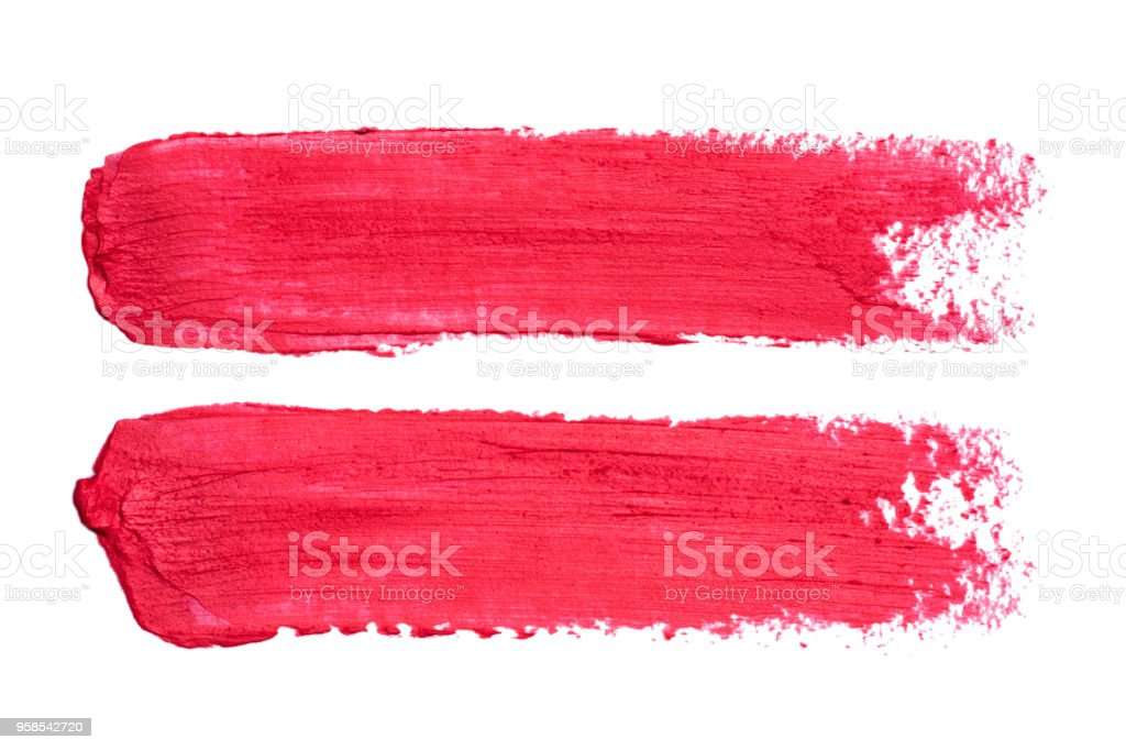 Photo of red lipstick smudges isolated on white background stock photo