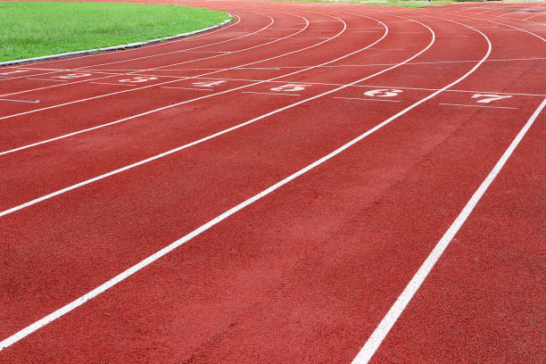 photo of red running track for competition or exercise, as background. sports concept. colorful tone. - linia zdjęcia i obrazy z banku zdjęć