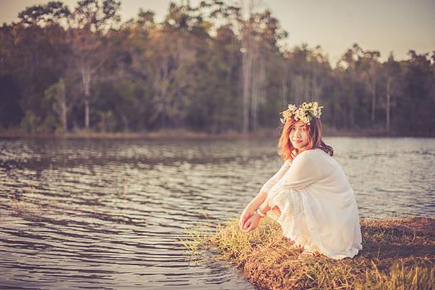photo of romantic woman in rain forest - teichfiguren stock-fotos und bilder