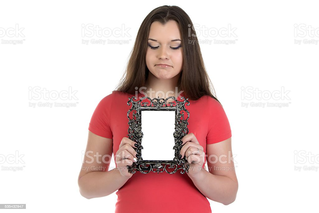 Photo of sad teenage girl with photo frame stock photo