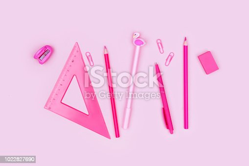 istock Photo of school supplies on pink background 1022827690