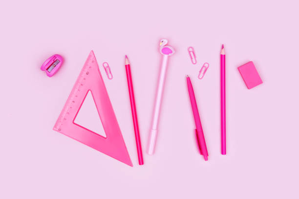 Photo of school supplies on pink background stock photo