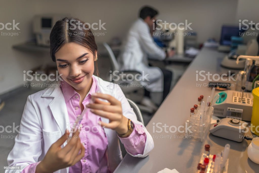 Photo of Scientist doctor looking at sample in test tube stock photo