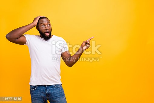 1163696387 istock photo Photo of shocked man thinking about how to stop showing you your best decision about buying something while isolated with vivid background 1167716119
