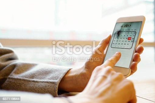 istock photo of smartphone with calendar screen 637119644