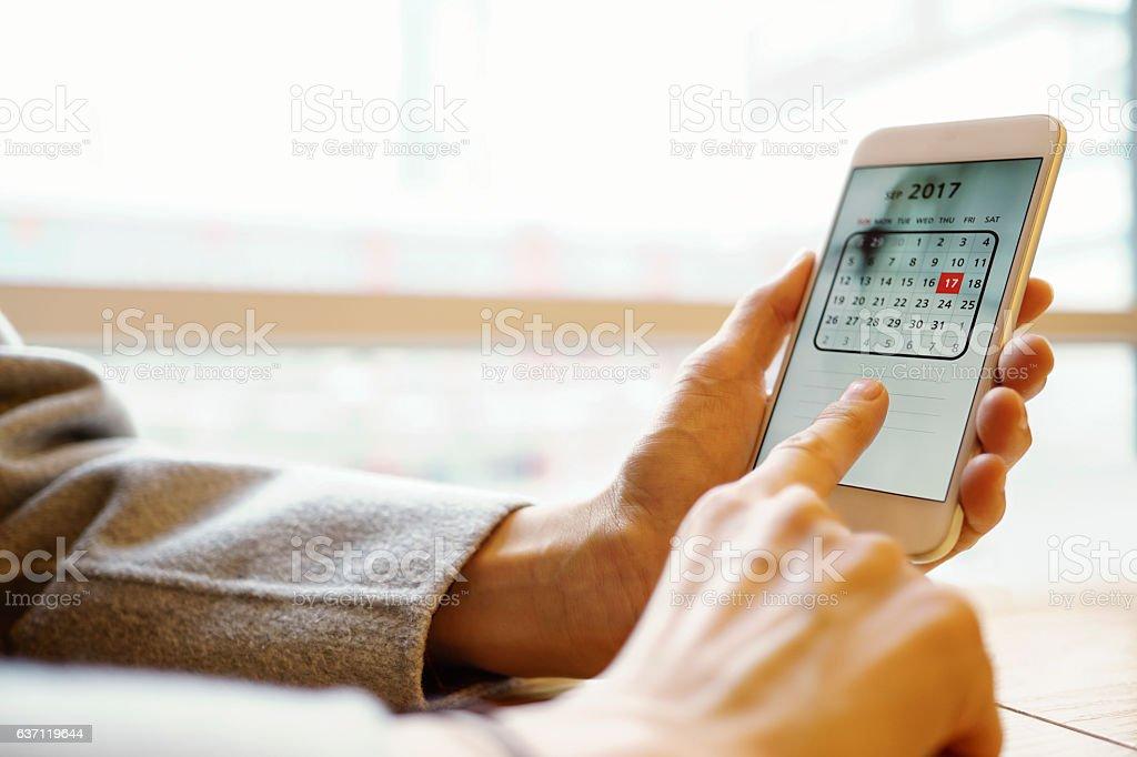 photo of smartphone with calendar screen stock photo