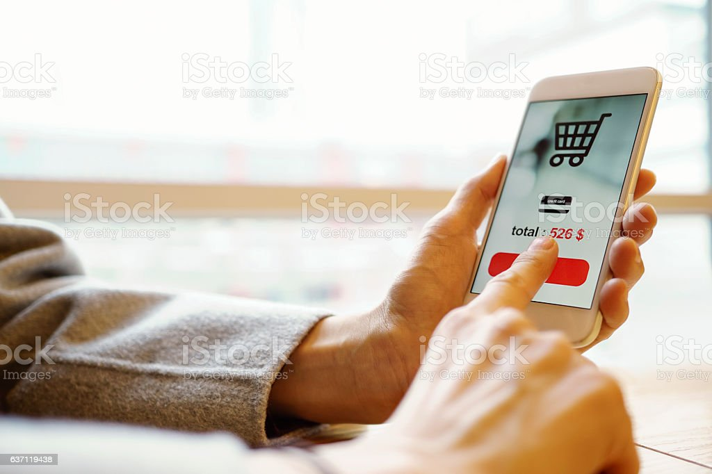 photo of smartphone with shopping screen stock photo