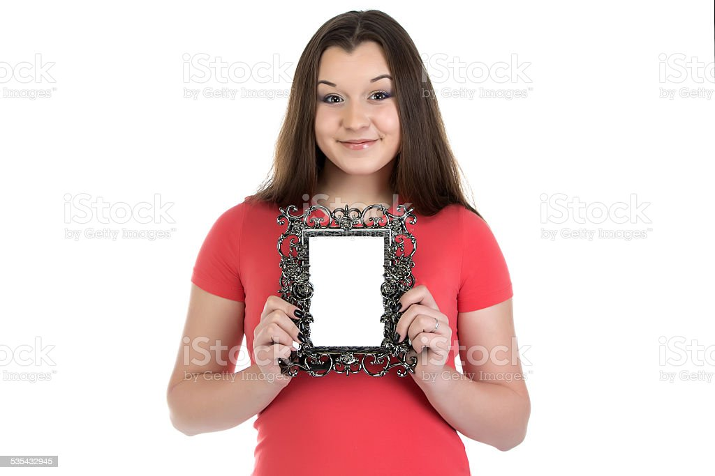 Photo of smiling teenage girl with photo frame stock photo