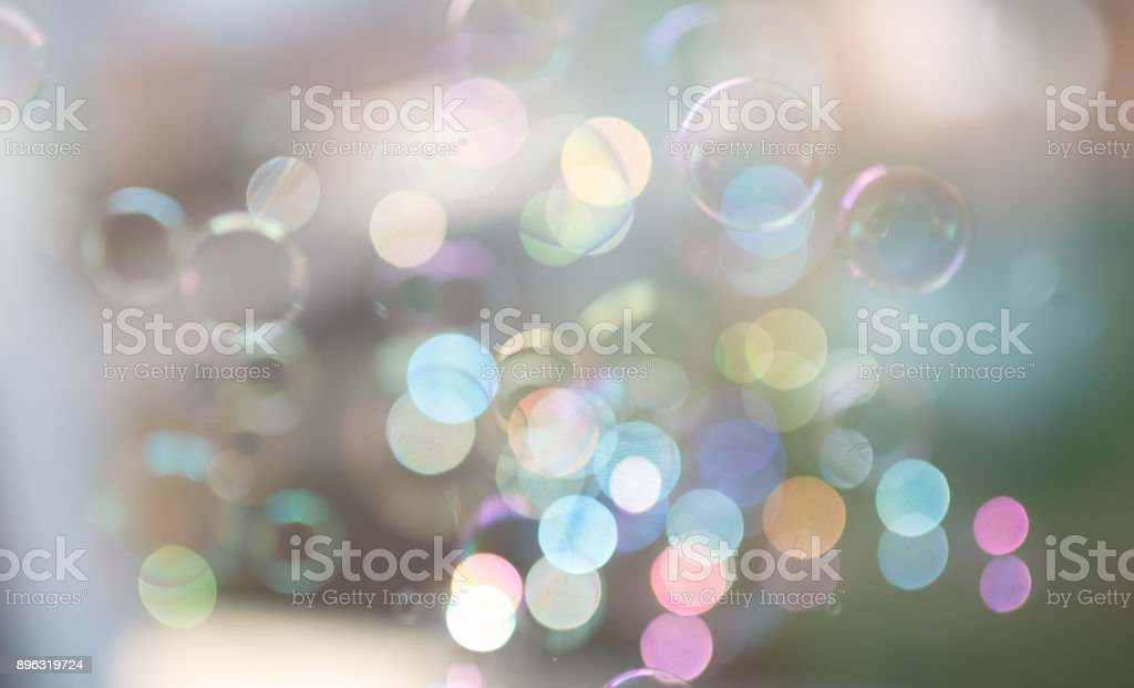 Photo of soap bubbles into the sunlight with beautiful bokeh, pastel colors. stock photo