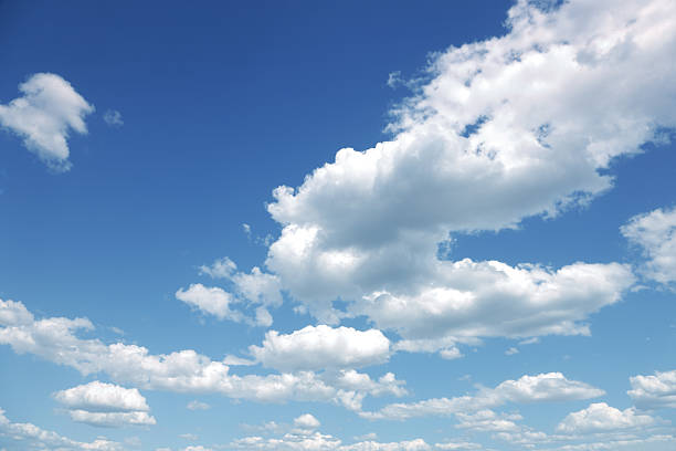 Photo of some white whispy clouds and blue sky cloudscape stock photo