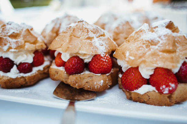 photo of Strawberry Cream Puffs on a plate stock photo