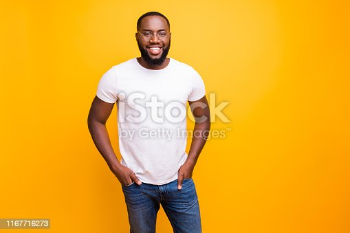 istock Photo of successful nice enjoying black man who confidently walks on his way to conquering tops of business while isolated with vivid background 1167716273