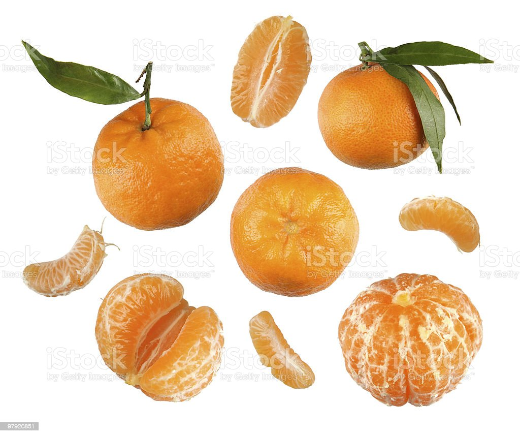 Photo of tangerines, some peeled, in segments and some whole royalty-free stock photo