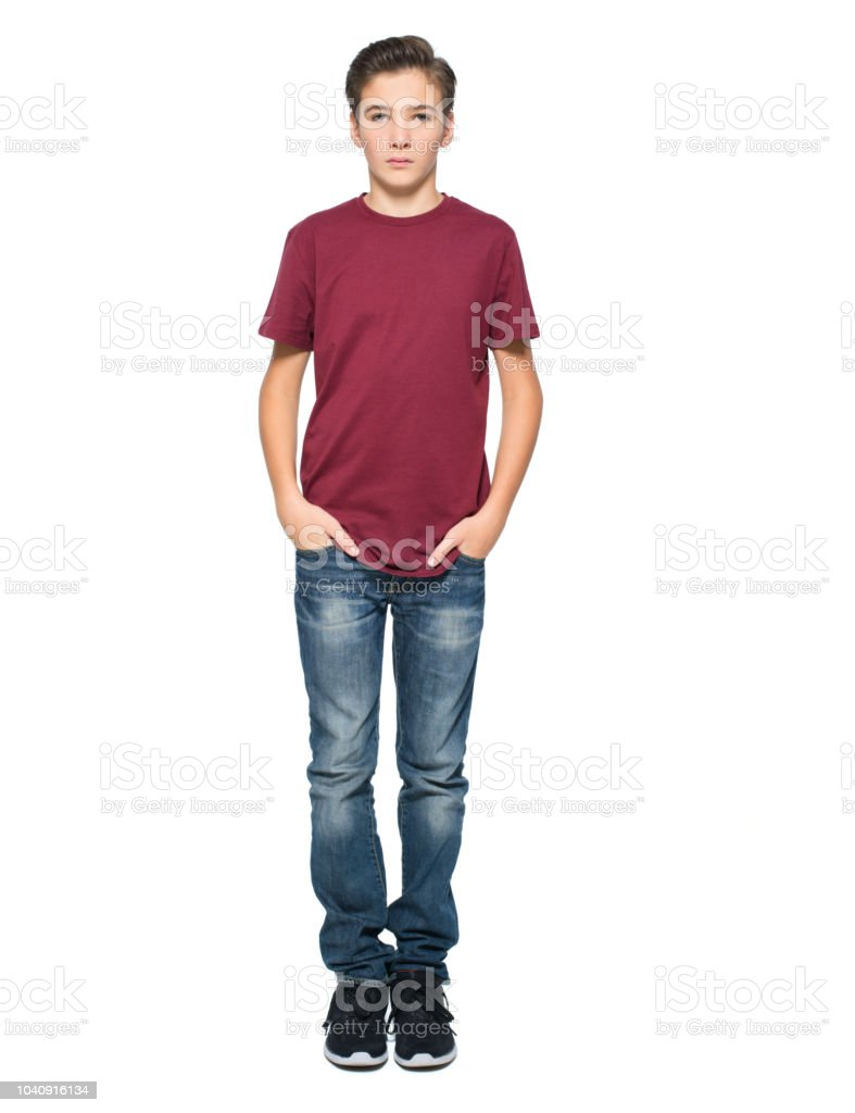 Photo of teenage young  boy posing at studio stock photo