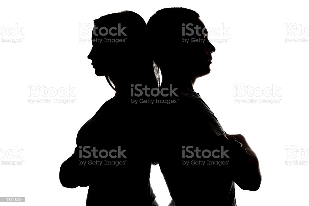 Photo of teenagers looking in different sides stock photo
