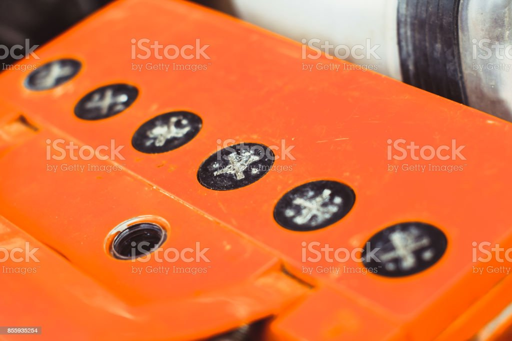 photo of the car battery under the hood stock photo