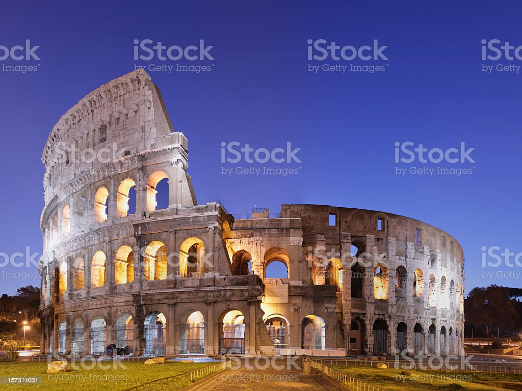 Photo of the Coliseum in Rome against blue sky stock photo